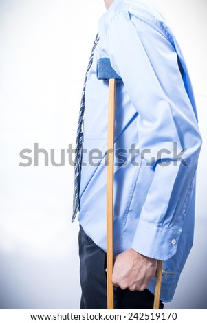 Employees with crutches, white background. Disabled person in work.  - stock photo