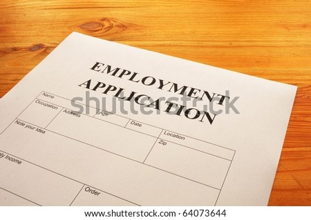 employment application form on desk showing job search concept