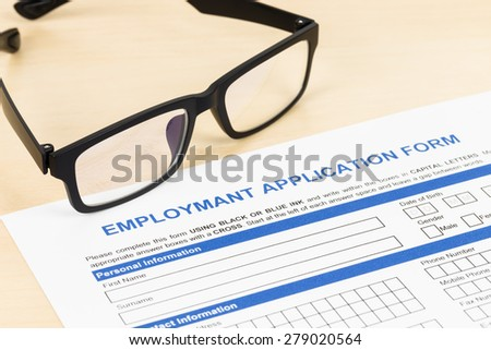 Employment application form with glasses concept job applying - stock photo