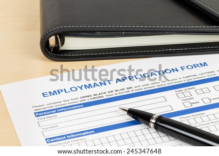 Employment application form with pen and organizer concept job applying - stock photo