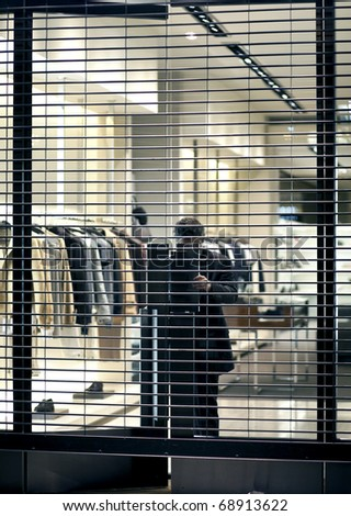 Employment closing a door by a big fashion store - stock photo