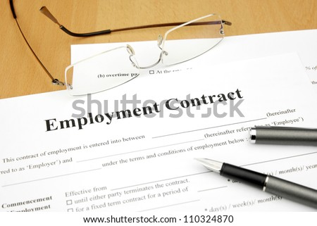 employment contract form with glasses and pen - stock photo