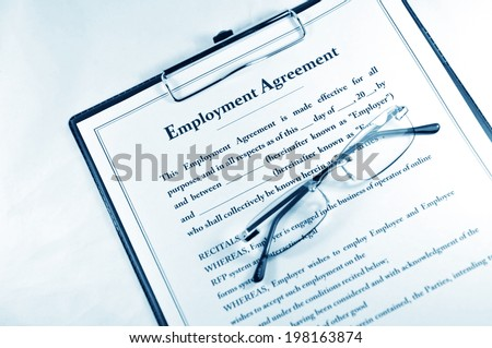 Employment contract with clipboard and glasses - stock photo
