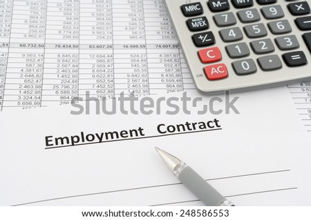 employment contract with numbers, calculator and pen