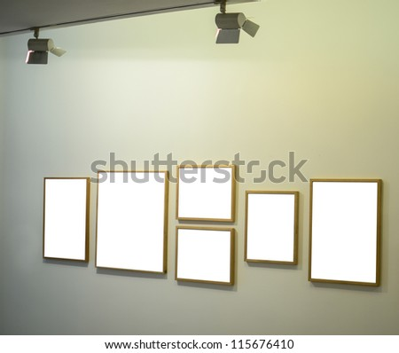 Empt frames on gallery wall