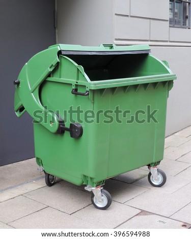 emptied garbage bin on a street - stock photo