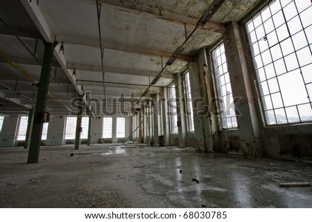 empty abandoned warehouse, perspective view - stock photo