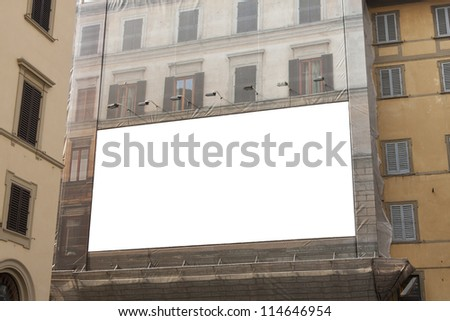 Empty advertisement billboard on a building in a european city - stock photo