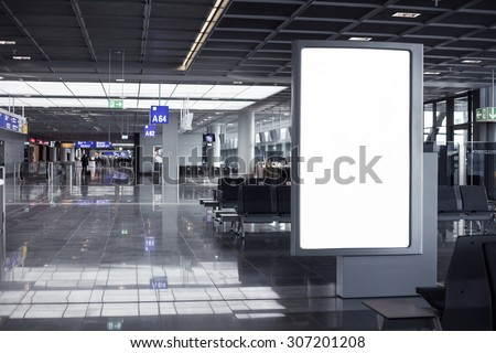 Empty advertising frame in airport - stock photo