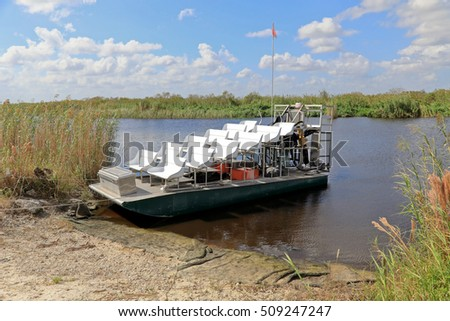 Empty airboat waiting for passengers for an ecotour of the Florida Everglades.