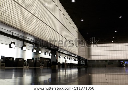 Empty airport lounge with clear info screens - stock photo