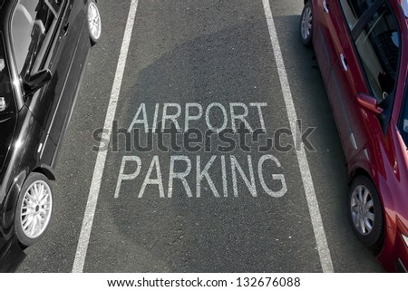 Empty airport parking bay with white markings - stock photo