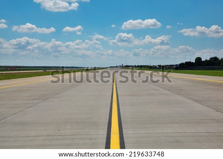 Empty airport runway (taxiway) - stock photo