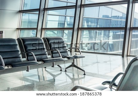 empty airport terminal waiting area with chairs. - stock photo