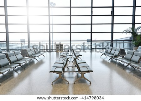 Empty airport terminal waiting area with chairs in Shanghai Hongqiao airport. - stock photo