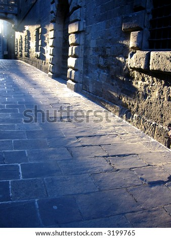 Empty alley with blue light - stock photo