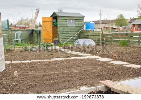 Empty allotment garden ready for planting new crops - stock photo