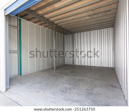 Empty aluminum garage with roller door