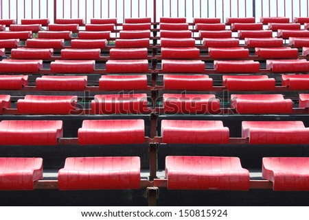 Empty and numbered seats in a stadium - stock photo