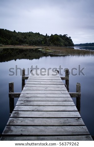 Empty and serene jetty on a moody winters day