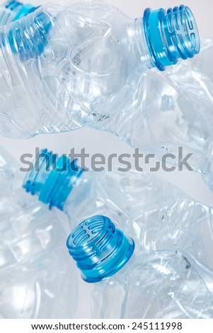 Empty and used plastic bootles - stock photo