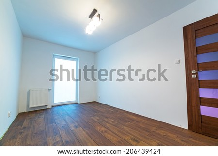 Empty apartment interior with wooden floor after renovation - stock photo