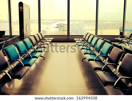 Empty armchairs in hall of airport ,with a retro effect - stock photo