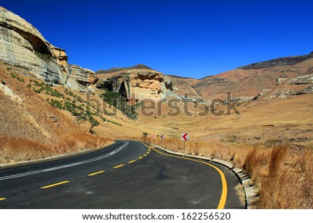 Empty asphalt road in Golden Gate Highlands National Park, South Africa