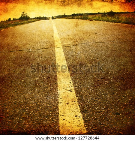Empty asphalt road in grunge and retro style. - stock photo