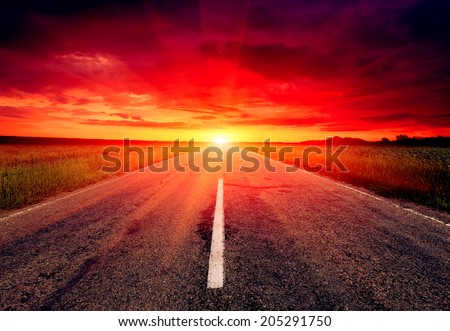 Empty asphalt road to sunset  - stock photo