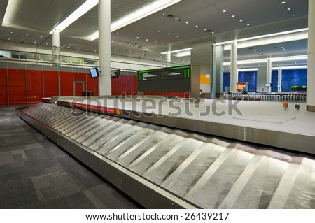 Empty baggage claim area at airport, waiting for luggage to arrive - stock photo