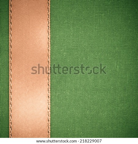 Empty banner on vintage background. Brown ribbon on green fabric cloth texture with copy space. Square format