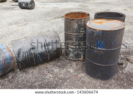Empty barrels of asphalt - stock photo