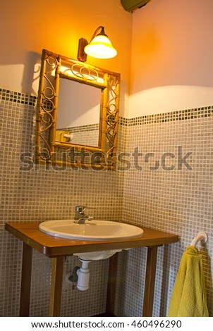 Empty bathroom decorated in a retro style - stock photo