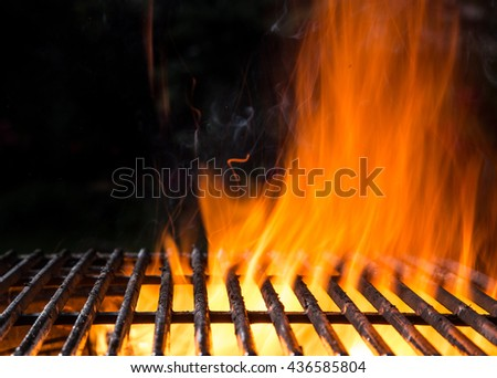 Empty BBQ Flaming Charcoal Cast Iron grill, close-up. - stock photo