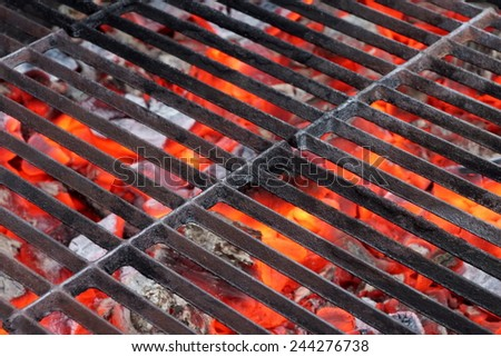 Empty BBQ Grill and Glowing Hot Coals.  Background with space for text or image. - stock photo