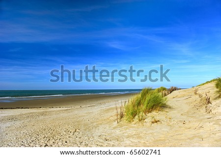 Empty beach at the island Ameland in Holland - stock photo