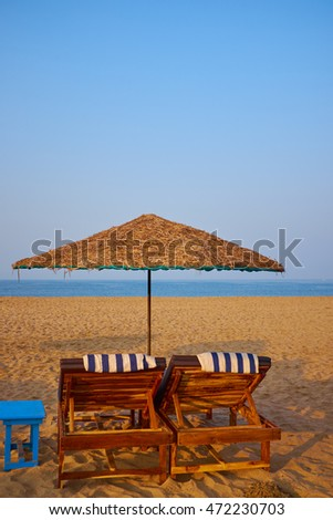 empty beach chairs on a tropical beach
