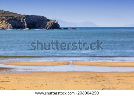 Empty beach during low tide - stock photo
