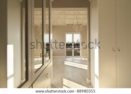 Empty bedroom inside a modern house - stock photo