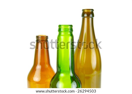 Empty beer bottles isolated against a white background