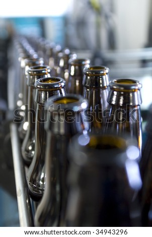 Empty beer bottles waiting to be filled on a productionline.