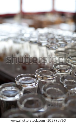 Empty beer glasses ready for use in the bar. abstract of bar counter with clean glasses ready for beer