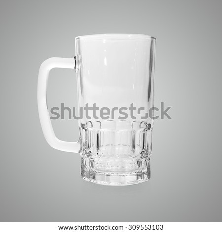 Empty beer mug on gray background