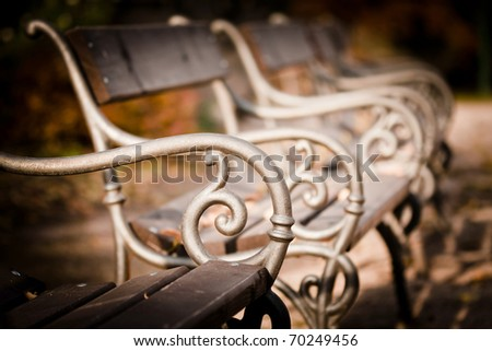 Empty bench in a park - stock photo