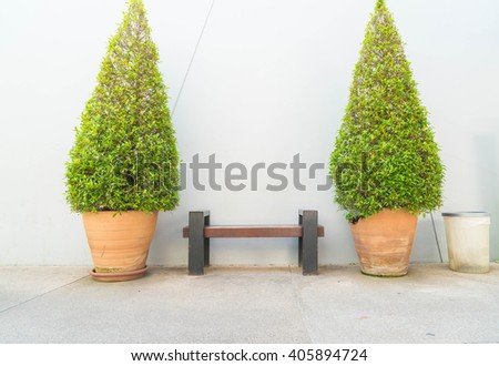 empty bench with tree and wall background - stock photo