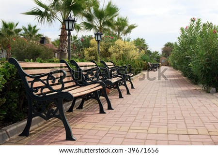 Empty Benches In Park With Lantern - stock photo