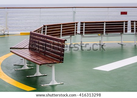 Empty Benches on Helicopter Pad of a Cruise Ship