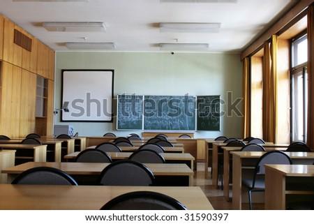 Empty big classroom at school - stock photo