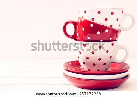 Empty big mugs polka dot, isolated on white background and blank space  - stock photo